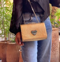 Bag jewelry leather gold with artisanal jewelry