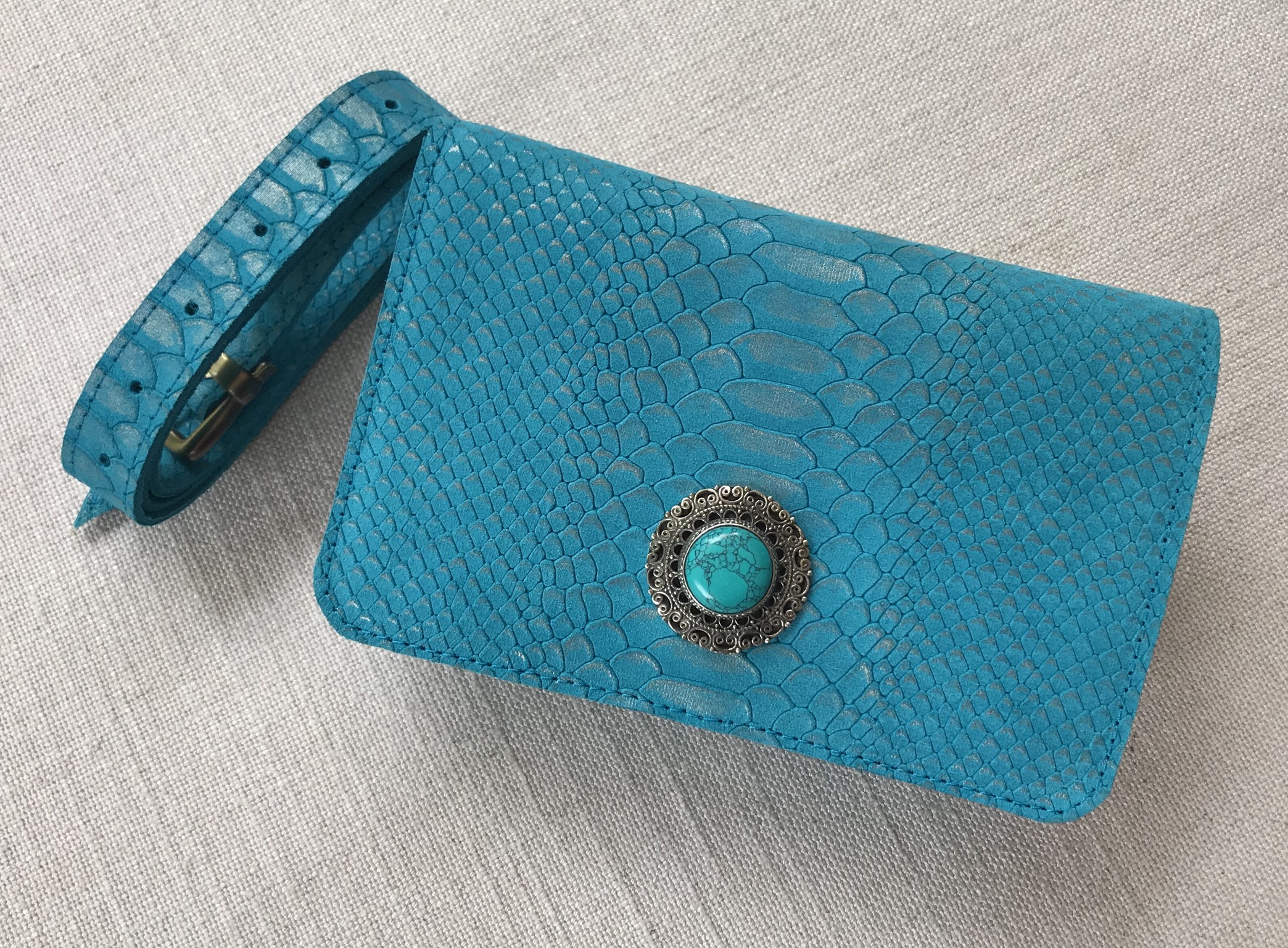 Beltbag Suede leather croco Turquoise with artisanal jewelry