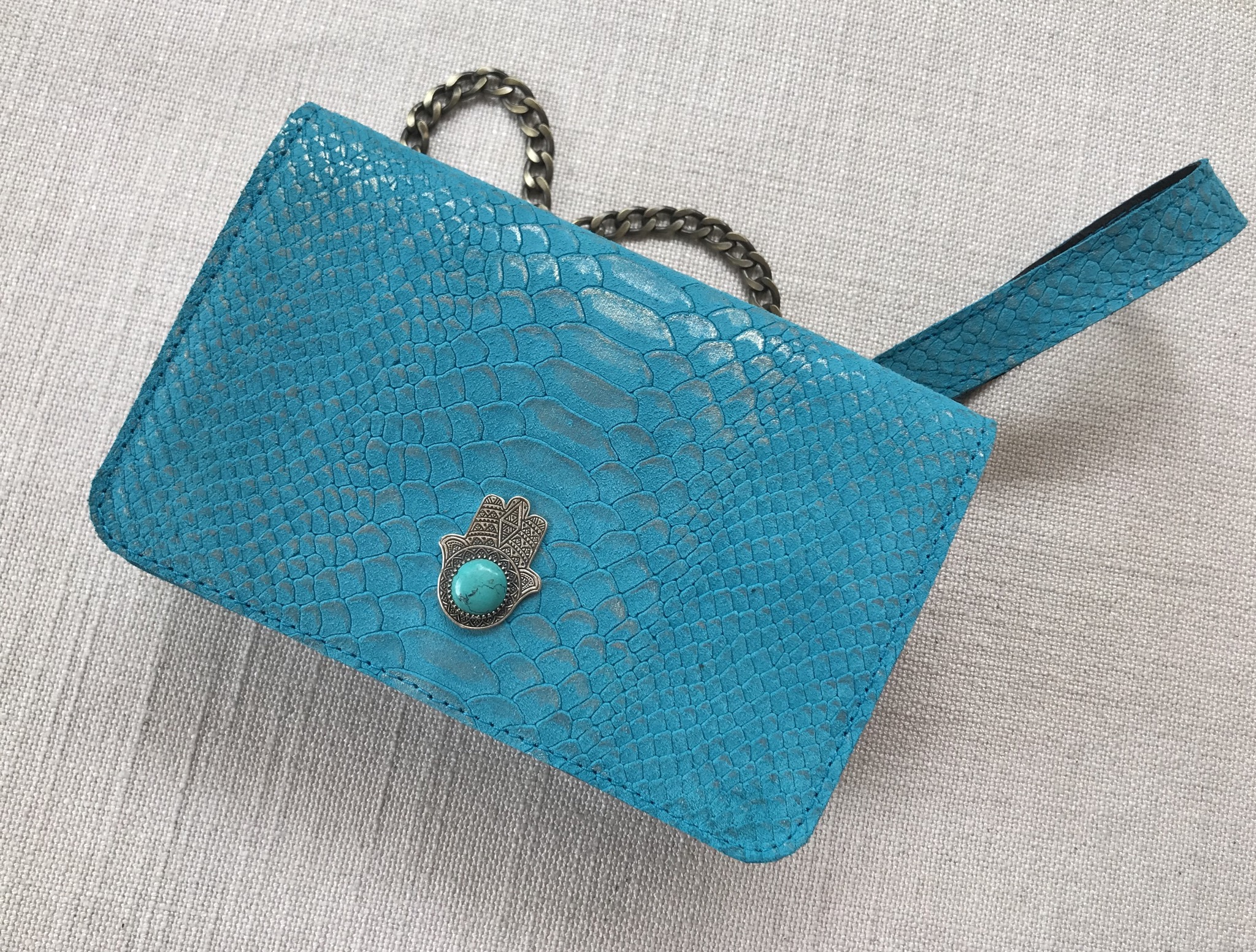 Jewelry bag leather croco turquoise with jewelry